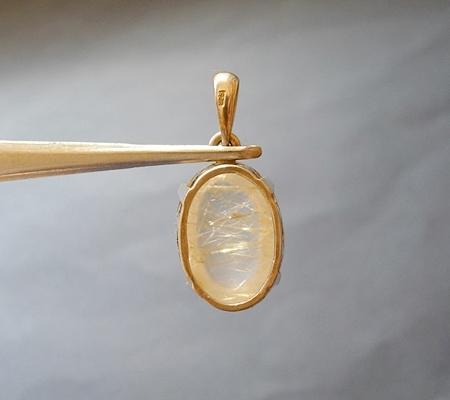 ヒマラヤ水晶ペンダント針金形状内包物入り074-3
